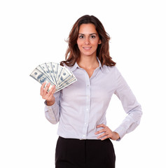 Lovely woman in blouse holding cash dollars