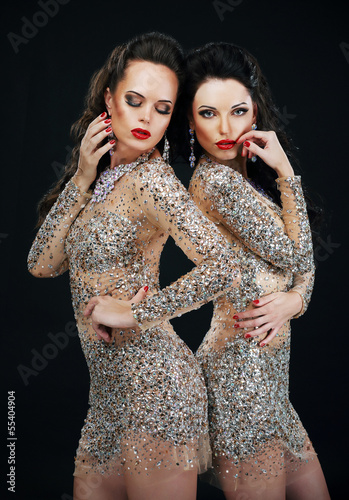 Luxury. Two Sexy Glamorous Women in Shiny Dresses