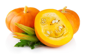 Ripe pumpkin vegetables with green levaes and blossom isolated