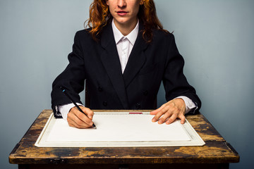 Businesswoman working at drawing board