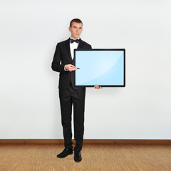 businessman holding plasma
