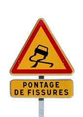 Danger temporaire : chaussée glissante