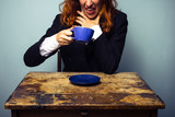 Businesswoman has had a very bad cup of coffee