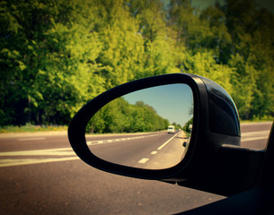 mirror of the car with the road