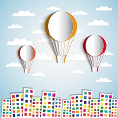 Three paper hot air balloons with paper houses
