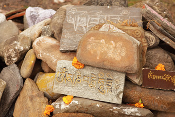 Stones with mantras in the Himalayas