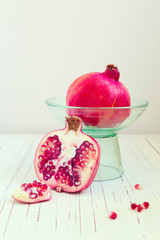 Pomegranate on wooden white table
