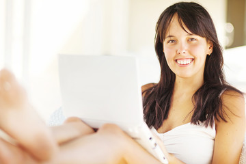 woman relaxing with laptop at home