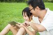 father teaching  little girl using tablet pc