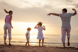 Happy family jumping on the beach on the dawn time - Fine Art prints
