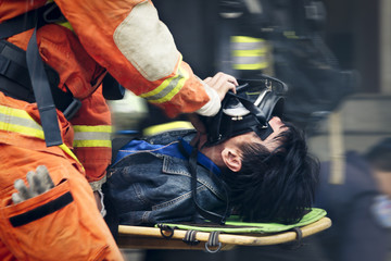 Rescue workers drills move hurt person with a stretcher