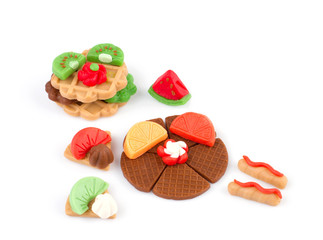 plasticine waffle and fruits toy display on white background