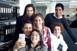 Group of teenagers taking a self portrait with smart phone