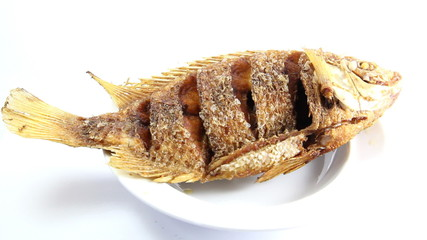 Closeup to Thai traditonal seafood deep fried fish