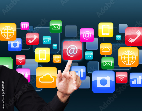 Businessman touching social application icon