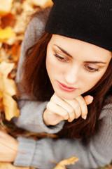 Autumn beautiful woman on leafs background