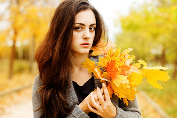 Autumn beautiful woman on leafs background