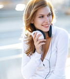 Enchanting young woman holds the headphones
