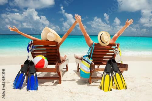 Happy couple on the beach of sea