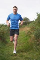 Man On Run In Countryside