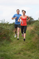 Couple On Run In Countryside