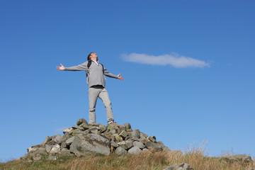 Male Walker Standing On Pile Of Rocks