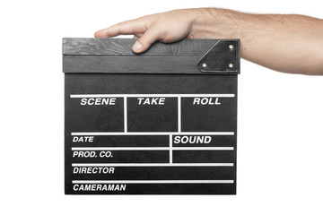 male hand holding movie production clapper board isolated on whi