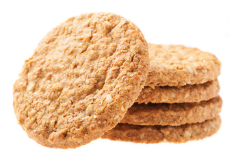 a pile of oats biscuits on a white background