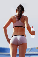 back of woman with bottle
