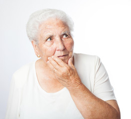 old woman concern thinking on a white background