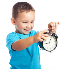 child holding an alarm clock on a white background