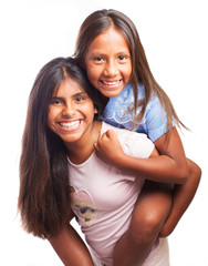 girls playing piggy back on a white background