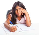 bored girl doing homewrok on a white background
