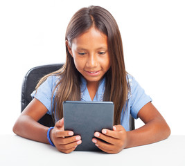 girl using a tablet on a white background
