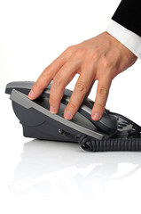 businessman's hand is picking up headset