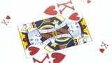Red king playing card rotates on white background