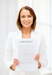 businesswoman holding contract