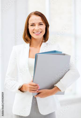 businesswoman with folders in office