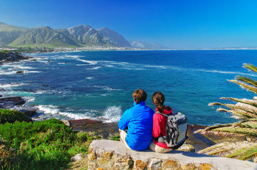 Couple looking at ocean view, vacation in South Africa