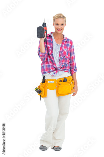 Woman standing holding a drill
