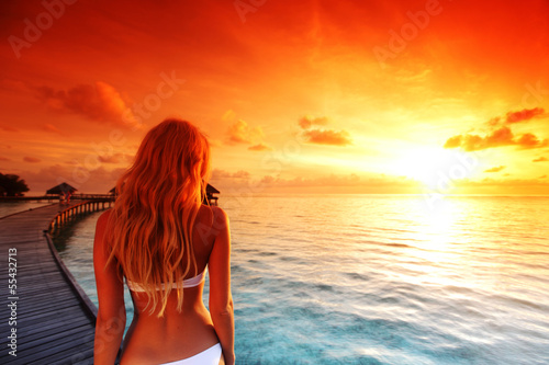 woman in a dress on maldivian sunset