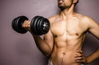 Fit young bodybuilder training with weights