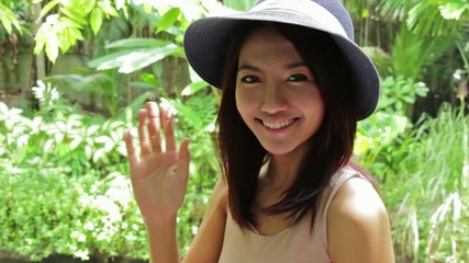 smiling woman waving her hand in nature : tripod HD