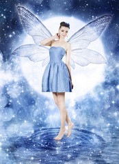 Beautiful young woman as blue fairy