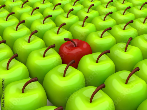 One red apple among background of green apples