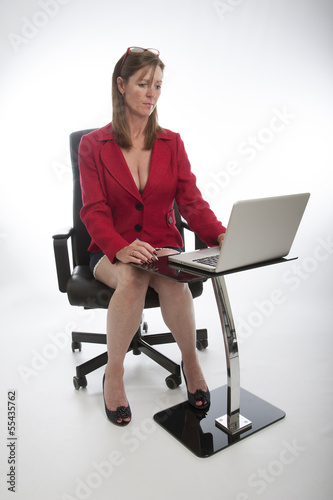 Female office worker  wearing a red jacket