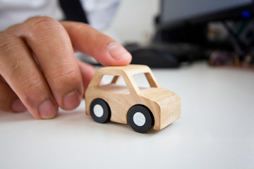 Wooden car on a table.