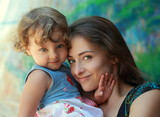 Beautiful smiling mother and happy fun kid girl looking. Portrai