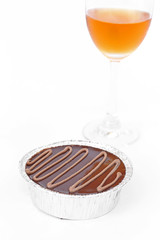 Cake chocolate and wine on white background