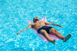 Young man relaxing on swimming pool.